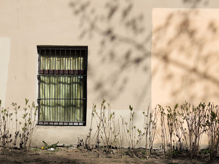 transom: Wall with a window, sunny spring day Stock Photo