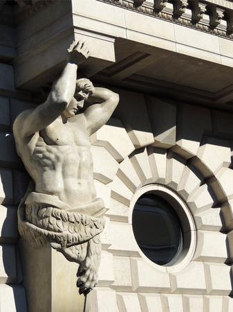 decorative balconies: Figure atlas, supporting balcony of building