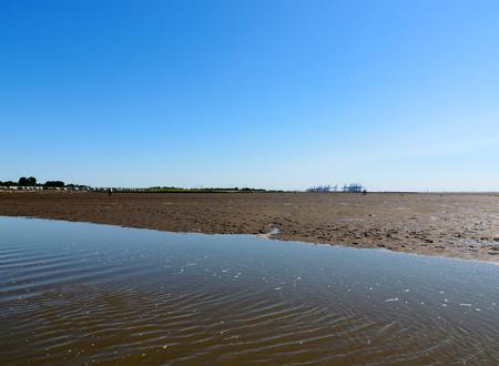 Coast of North Sea at low tide, watts Фото со стока