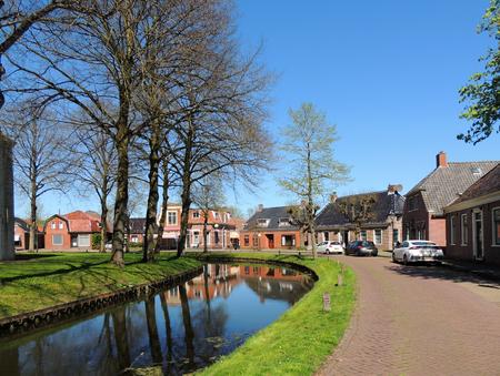 Central street in Spijk, Dutch province Groningen, Netherlands