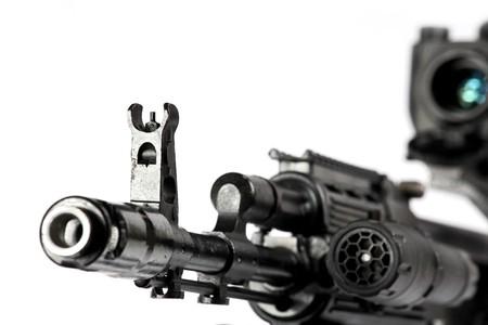 arms trade:  Machine gun on the tripod and optical sight