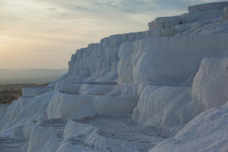 basins: White ancient calcium natural basins landscape in the evening Pamukkale, Turkey, nobody