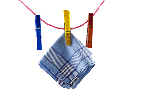 Belov on the background, rope, rope clothespins , one clothespin hangs a handkerchief. Stock Photo