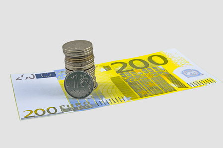 coin one ruble and the European currency: banknotes of five and fifty euro coins. Isolate.