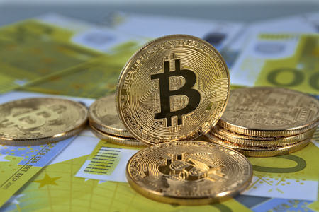Coins Bitcoin on the background of the Euro Stock Photo