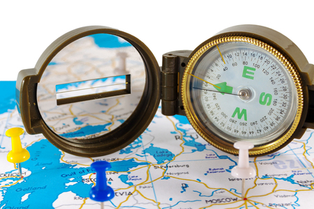 Magnetic compass on a world map conceptual of global travel , tourism and exploration. Stock Photo