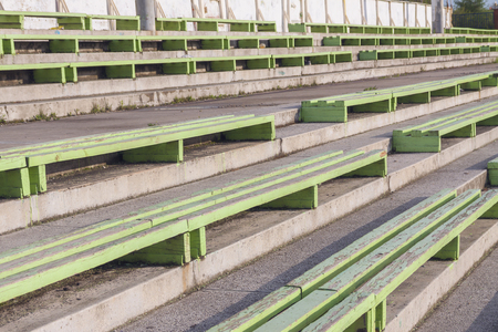 Old wooden benches in an abandoned stadium