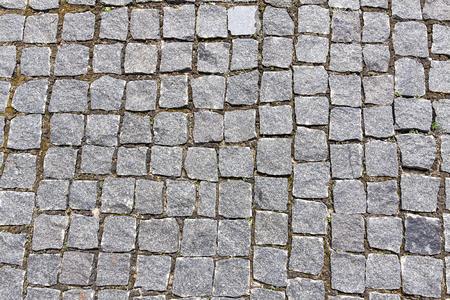 Modern pedestrian path made of brown stone of medium size