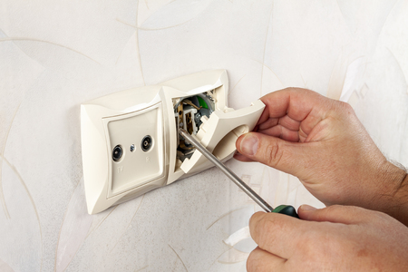 Repair of electrical outlets. Wire drawing with a screwdriver. Reklamní fotografie