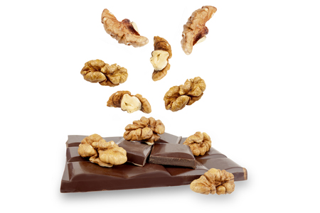 dark chocolate bar with walnuts on a white background.