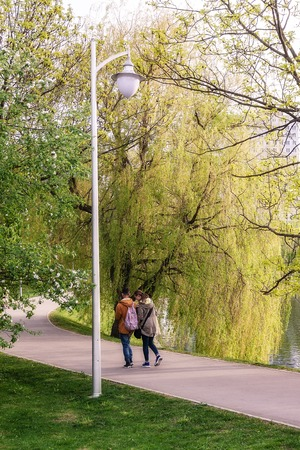 Kaliningrad Russia 05.01.2019 Young couple walking in Spring park in the evening Reklamní fotografie - 125338643