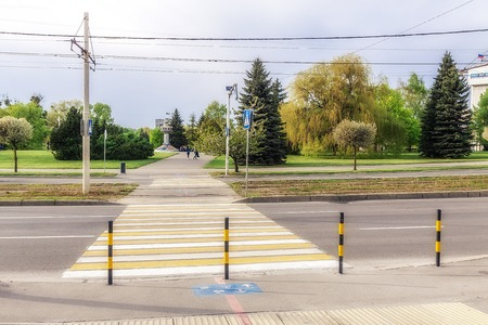 Zebra crosswalk across the road in a big city 写真素材