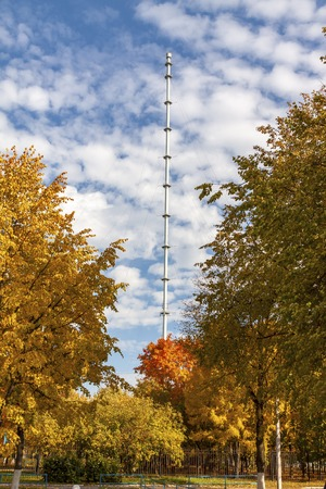 TV tower against the background of autumn trees. Stockfoto