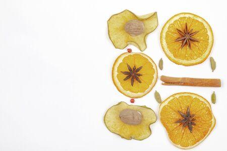 Dried lemon cinnamon star anise on a light background Reklamní fotografie