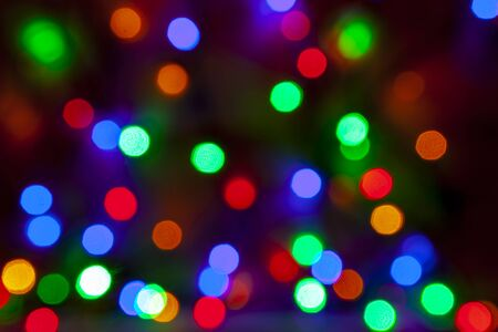 Defocused abstract christmas background of multi-colored light bulbs. Reklamní fotografie