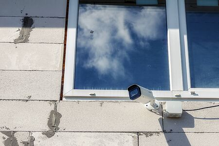 Surveillance camera hanging on the wall at home