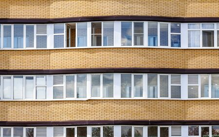 The facade of a high-rise residential building close-up Stock Photo