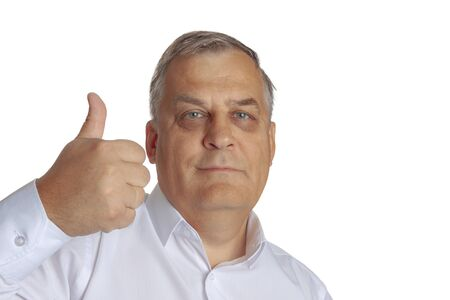Aged man on a white background shows with his hand that he is doing fine