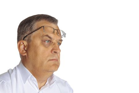 A man aged with glasses on his forehead. On a white background.