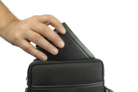 The hand pulls out, puts the wallet out of the bag. On white background