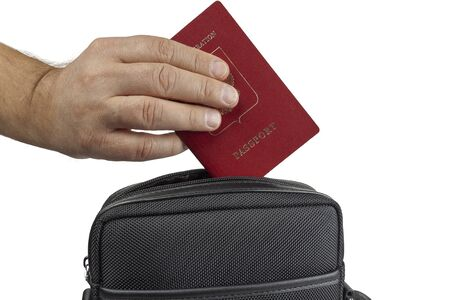 A hand pulls out a passport from a bag on a white background, close-up Stok Fotoğraf