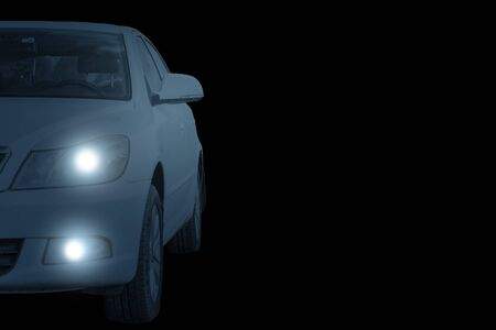 A car with lights on a black background