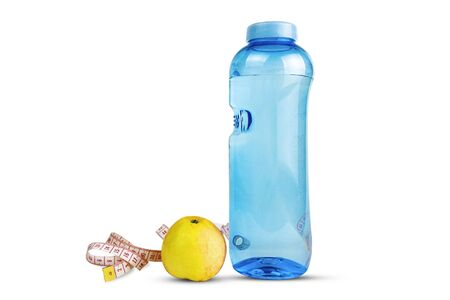 Fitness bottle with apple and measuring tape