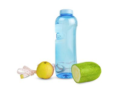 Fitness bottle with apple, zucchini and measuring tape 写真素材