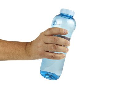 Hand holds fitness water bottle on white background, close up 写真素材