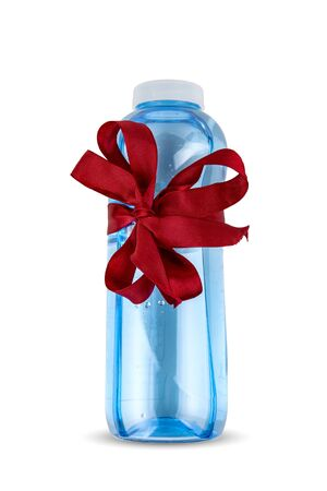Gift, fitness bottle with a red bow on a white background