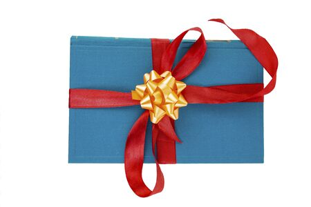 Gift book wrapped in red ribbon with a bow on a white background