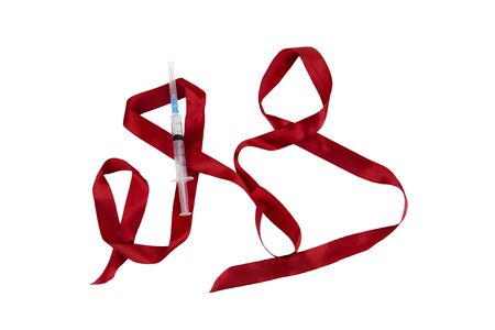 Red ribbon with a medical syringe on a white background 写真素材