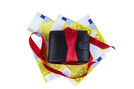 Present. Wallet with a red ribbon and money on a white background.