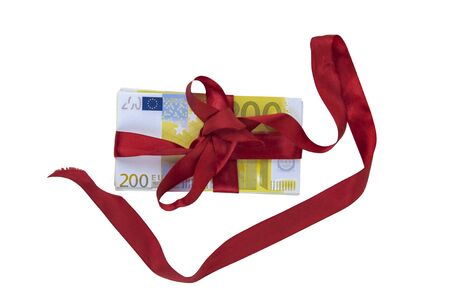 Present. Money tied with a red ribbon on a white background.