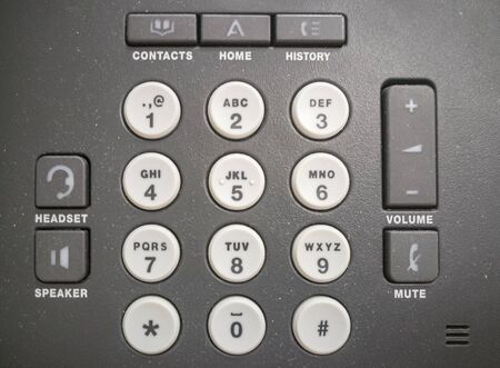 The buttons of a modern landline phone close-up