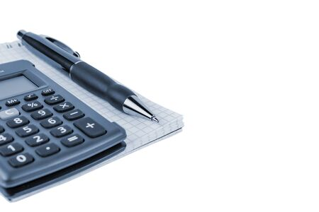 Automatic pen, calculator, notebook on a white background close-up.
