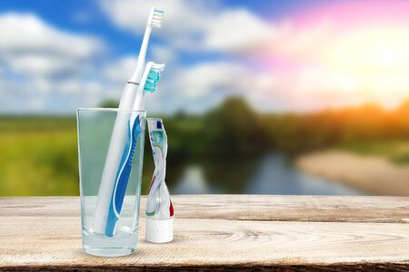 Toothbrushes in the background of the river