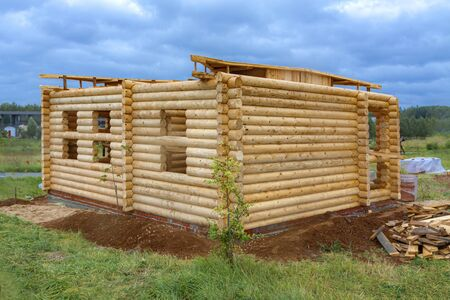 Construction of a new, small wooden log house 写真素材