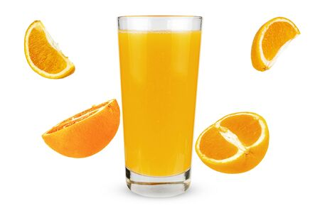 Glass of juice with falling oranges