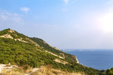 Evening over a high and steep seashore 写真素材
