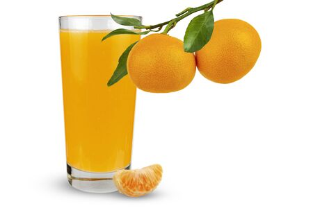Tangerines hang on a branch against the background of a glass with juice. Isolate 写真素材