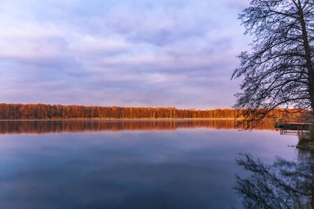 Nature, early morning on a lake with clouds