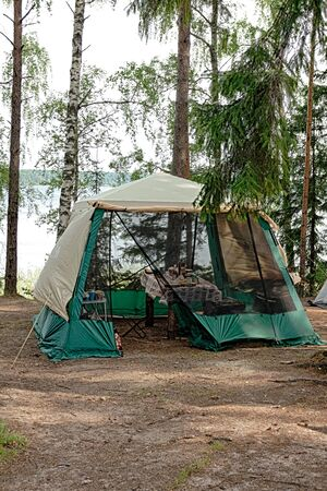 Camping on the lake in the woods