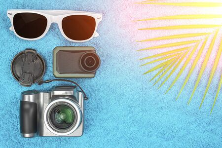 Theme of travel. Video photo gadgets with glasses lie on a colored background.