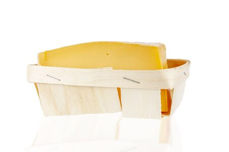 Cheese lies in birch bark packaging on a white background, isolate. Zdjęcie Seryjne