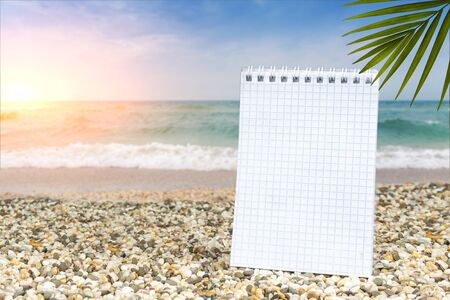 Notebook for notes on the beach at sunset