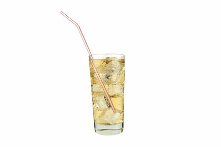 Glass of lemonade and ice cubes on a white background