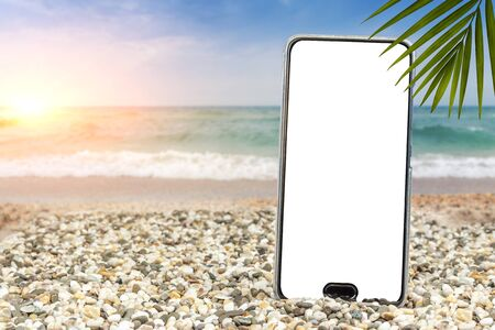 Pattern for text. Phone on the beach by the sea