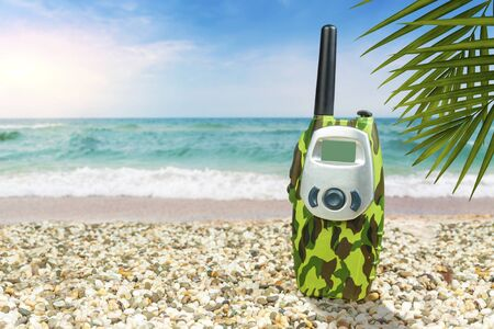 A small walkie-talkie on the beach