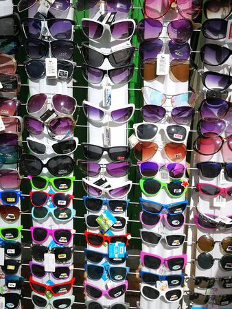Sunglasses are hanging on a shop window
